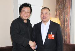 张俊以两会系列专访:台湾省著名企业家蔡培辉代表